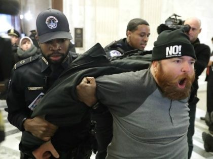 A protester shouts, 'No Trump, No KKK, No facist USA' as he is hauled out of the Senate Judiciary Committee's confirmation hearing for Sen. Jeff Sessions (R-AL) to be the next U.S. Attorney General in the Russell Senate Office Building on Capitol Hill January 10, 2017 in Washington, DC.