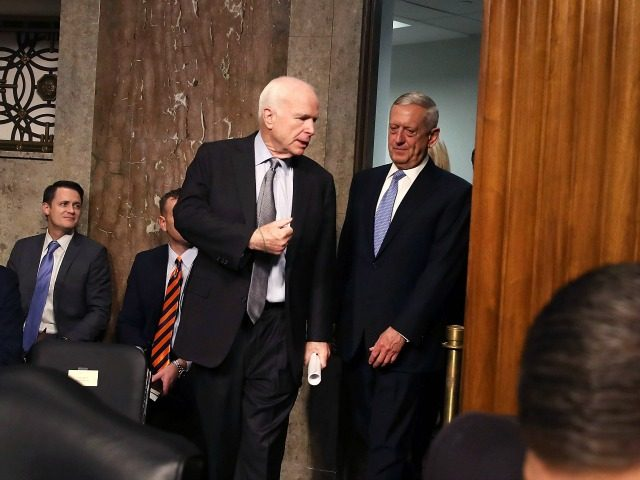 Defense Secretary nominee retired Marine Corps Gen. James Mattis (R) walks into his Senate Armed Services Committee confirmation hearing with Chairman John McCain (R-AZ), on Capitol Hill, on January 12, 2017 in Washington, DC. Gen. Mattis will need a waiver from Congress to bypass a law prohibiting recently retired military …