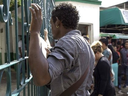 Cubans remain outside the National Immigration Institute with the hope of obtaining a safe-conduct that will allow them to reach the border with the United States, in Tapachula, Chiapas state, Mexico on January 16, 2017. US President Barack Obama ended a decades-old policy that allowed Cuban migrants who arrived illegally …
