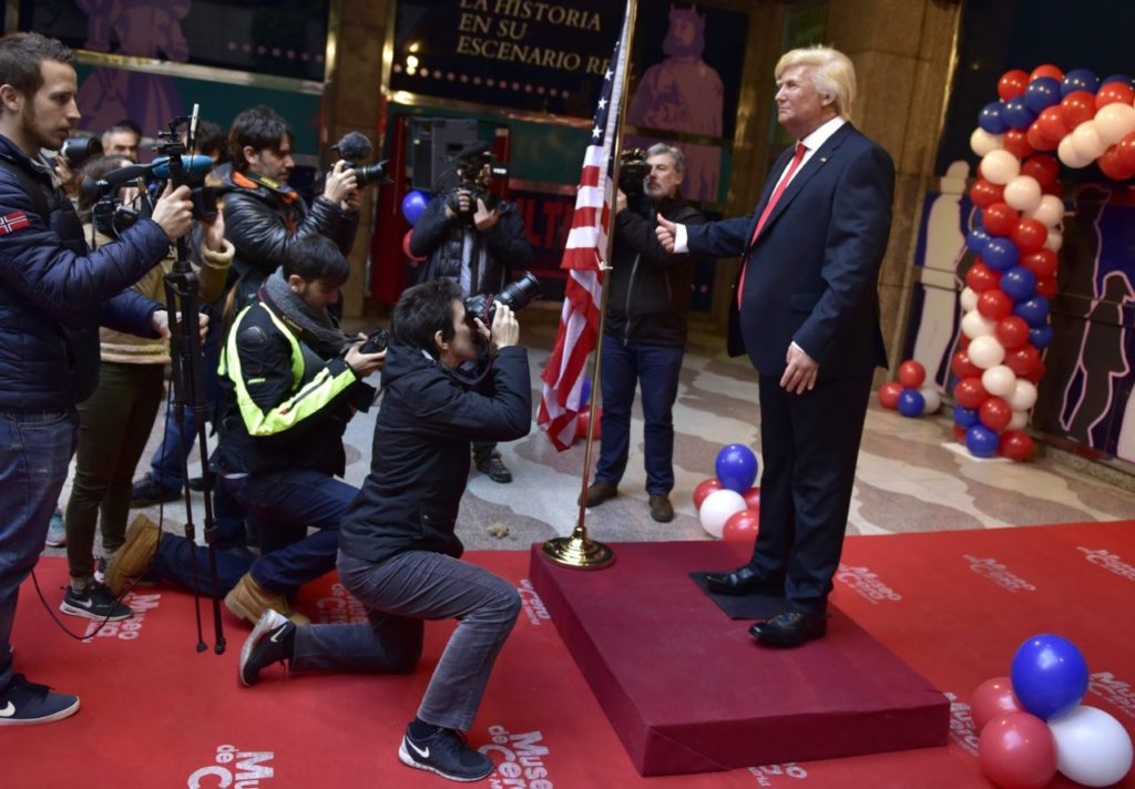 Medias film and take pictures of the wax statue of US President-elect Donald Trump during its presentation at the Wax Museum of Madrid on January 17, 2017. / AFP / GERARD JULIEN (Photo credit should read GERARD JULIEN/AFP/Getty Images)