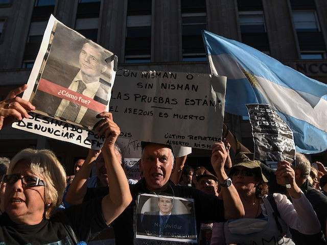 Activists take part in a ceremony marking the second anniversary of the controversial death of Argentinian prosecutor Alberto Nisman on January 18, 2017 in Buenos Aires. Nisman died in mysterious circumstances in January 18, 2015, after accusing Argentina's then president, Cristina Fernandez de Kirchner, of obstructing his investigation of a 1994 bombing at a Buenos Aires Jewish center. / AFP / EITAN ABRAMOVICH (Photo credit should read EITAN ABRAMOVICH/AFP/Getty Images)