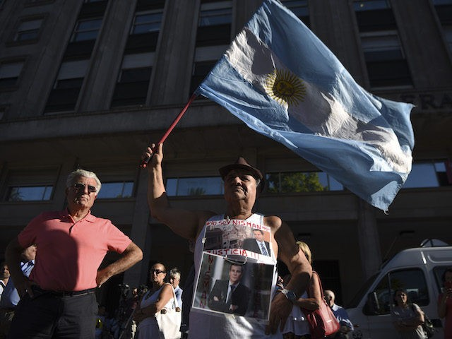 Activists take part in a ceremony marking the second anniversary of the controversial death of Argentinian prosecutor Alberto Nisman on January 18, 2017 in Buenos Aires. Nisman died in mysterious circumstances in January 18, 2015, after accusing Argentina's then president, Cristina Fernandez de Kirchner, of obstructing his investigation of a …