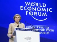 Theresa May Defends Brexit AND 'Globalisation' Before Davos Elite
