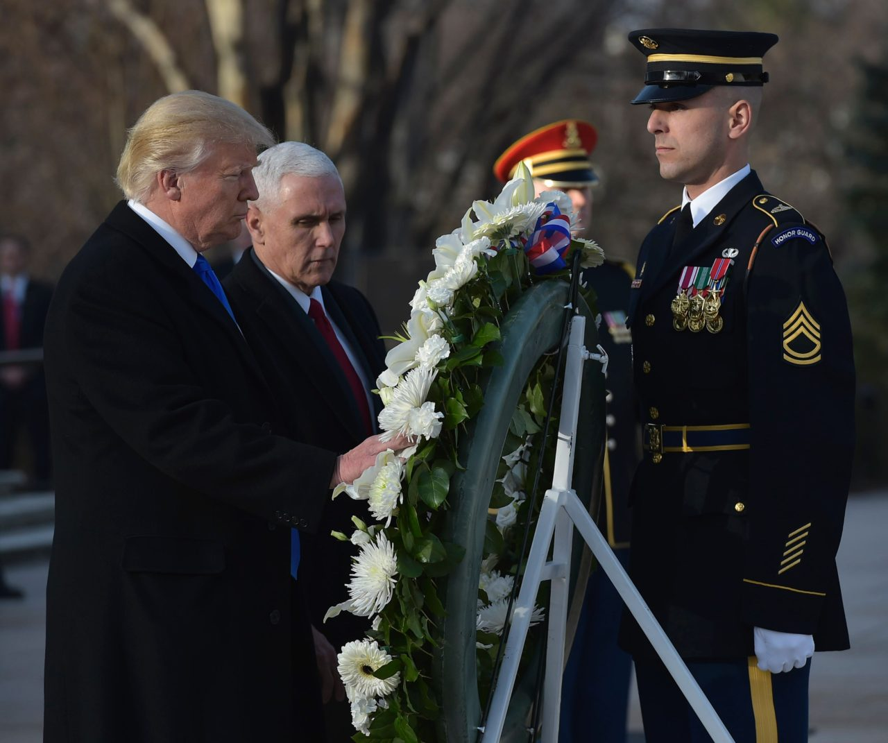 US President-elect Donald Trump and Vice President-elect Mike Pence take part in a wreath-laying ceremony at Arlington National Cemetery in Arlington,Virginia, on January 19, 2017. (Photo: MANDEL NGAN/AFP/Getty Images)