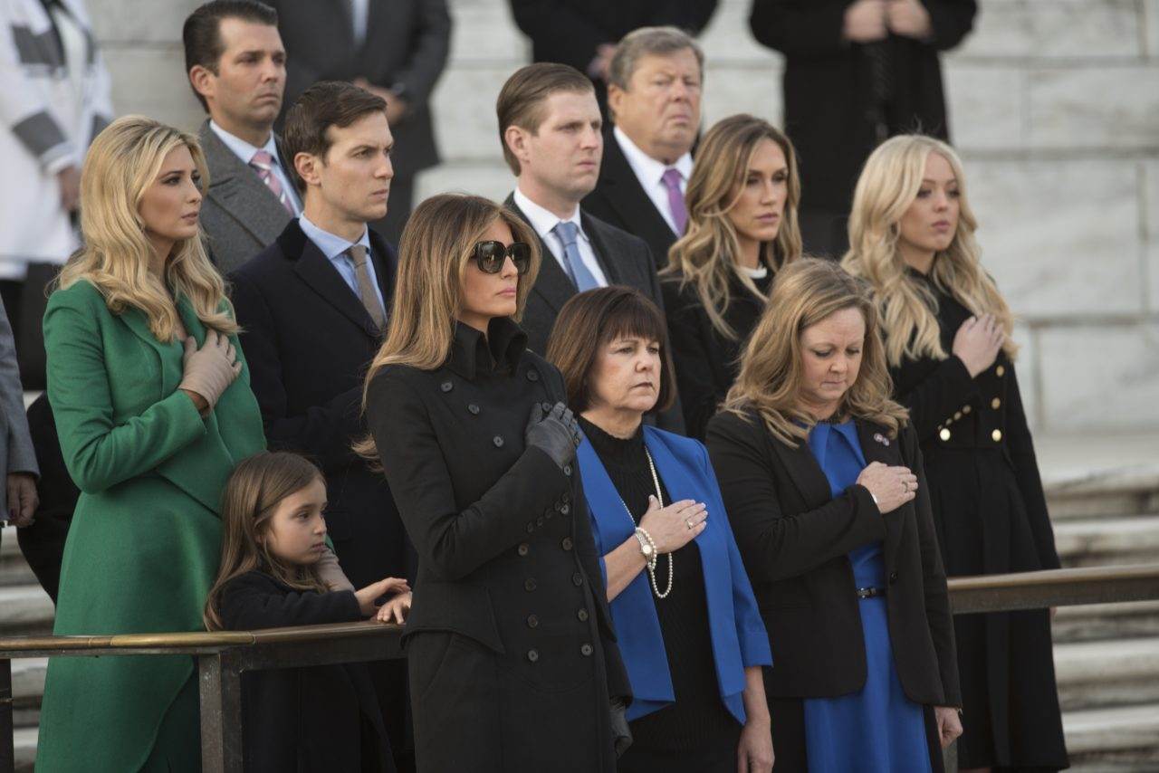 Family member watch as US President-elect Donald Trump and Vice President-elect Mike Pence take part in a wreath-laying ceremony at Arlington National Cemetery in Arlington, Virginia on January 19, 2017. (Photo: MANDEL NGAN/AFP/Getty Images)
