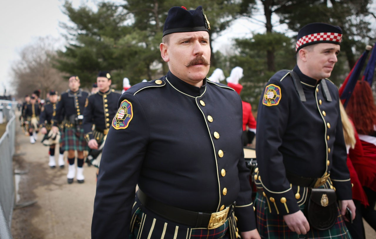 WASHINGTON, DC - JANUARY 19: Members of the Emerald Society, Washington, DC Fire Department band, walk on their way to perform at the Voices for the People inaugural musical event on January 19, 2017 in Washington, DC. President-elect Donald Trump will be sworn in as the 45th U.S. president on January 20. (Photo by Mario Tama/Getty Images)