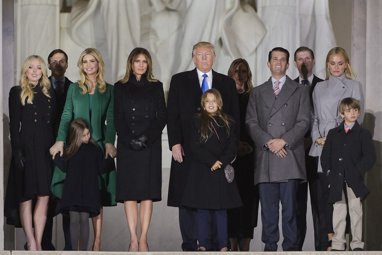 US President-elect Donald Trump and family pose at the end of a welcome celebration at the Lincoln Memorial in Washington, DC, on January 19, 2017. / AFP / MANDEL NGAN (Photo credit should read MANDEL NGAN/AFP/Getty Images)