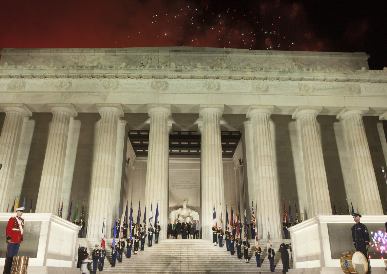 WASHINGTON, DC - JANUARY 19: (AFP OUT) President-elect Donald J. Trump and family stand in front of the Lincoln Memorial as fireworks expolode overhead at the inaugural concert in January 19, 2017 in Washington, DC. Hundreds of thousands of people are expected tomorrow for Trump's inauguration as the 45th president of the United States. (Photo by Chris Kleponis-Pool/Getty Images)
