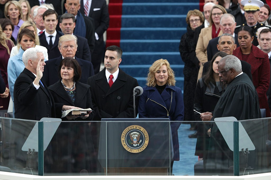 WASHINGTON, DC - JANUARY 20: Vice President Mike Pence takes the oath of office from Supreme Court Clarence Thomas as wife Karen Pence holds a bible on the West Front of the U.S. Capitol on January 20, 2017 in Washington, DC. In today's inauguration ceremony Donald J. Trump becomes the 45th president of the United States. (Photo by Alex Wong/Getty Images)