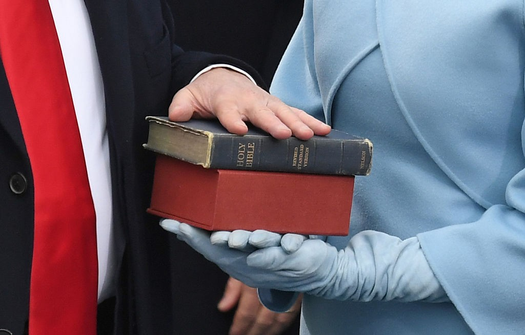 US President-elect Donald Trump's wife holds a Bible as Trump is sworn in as President on January 20, 2017 at the US Capitol in Washington, DC. / AFP / Mark RALSTON (Photo credit should read MARK RALSTON/AFP/Getty Images)