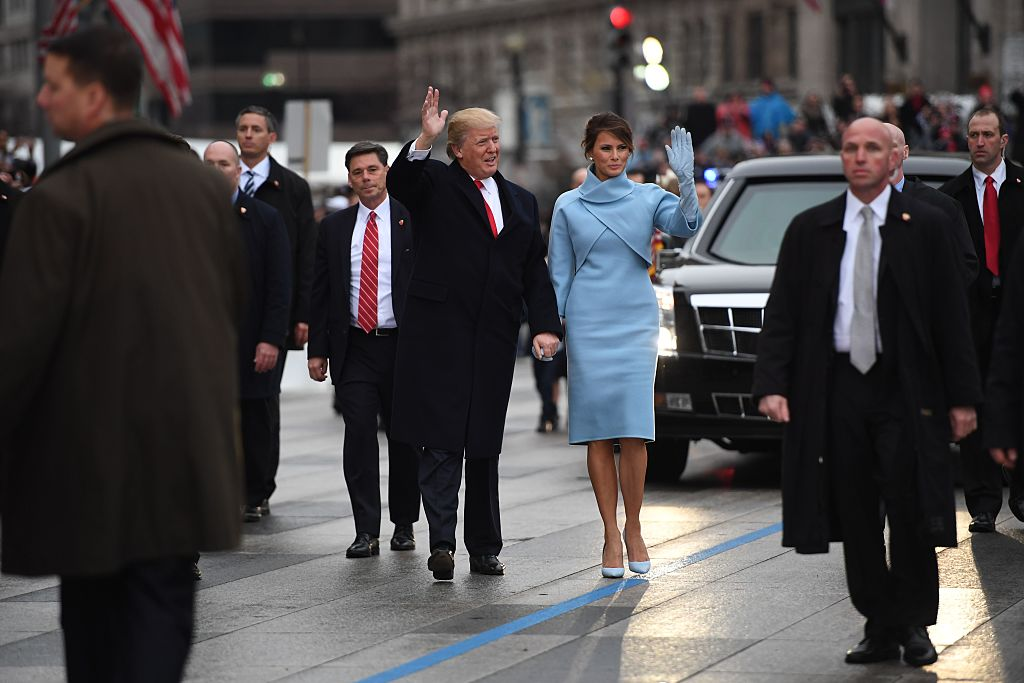 US President Donald Trump and First Lady Melania walk the inaugural parade route with son Barron (R) on Pennsylvania Avenue in Washington, DC, on January 20, 2107 following swearing-in ceremonies on Capitol Hill earlier today. / AFP / JIM WATSON (Photo credit should read JIM WATSON/AFP/Getty Images)