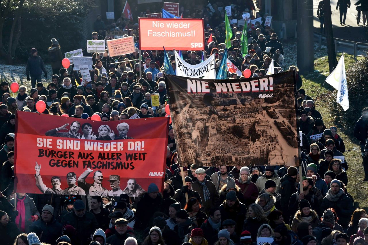 """""""never again"""" (R), """"they are back"""" (L) and """"never fascism again"""" (C) (PATRIK STOLLARZ/AFP/Getty Images)"""