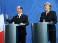 German Chancellor Angela Merkel (R) and French President Francois Hollande