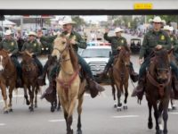 Border Patrol agents on horseback were invited to ride in the …