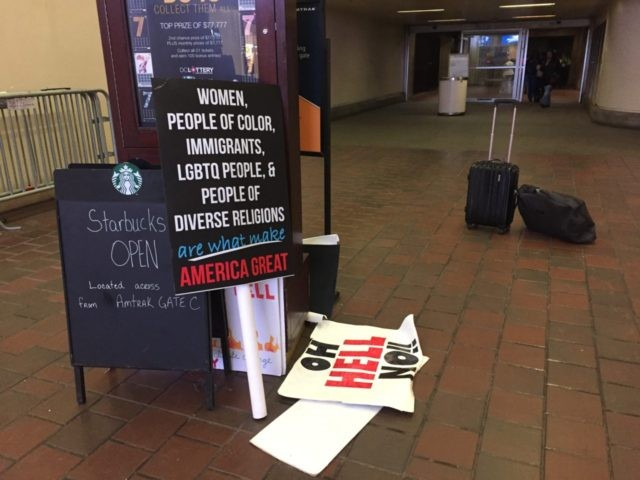 Protest signs at Union Station (Joel Pollak / Breitbart News)
