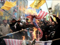 Iranians burn US flags outside the former US embassy in Tehran on November 4, 2013, during a demonstration to mark the 34th anniversary of the 1979 US embassy takeover. Thousands of Iranians shouted 'Death to America' as they demonstrated 34 years after Islamist students stormed the embassy compound in Tehran, …