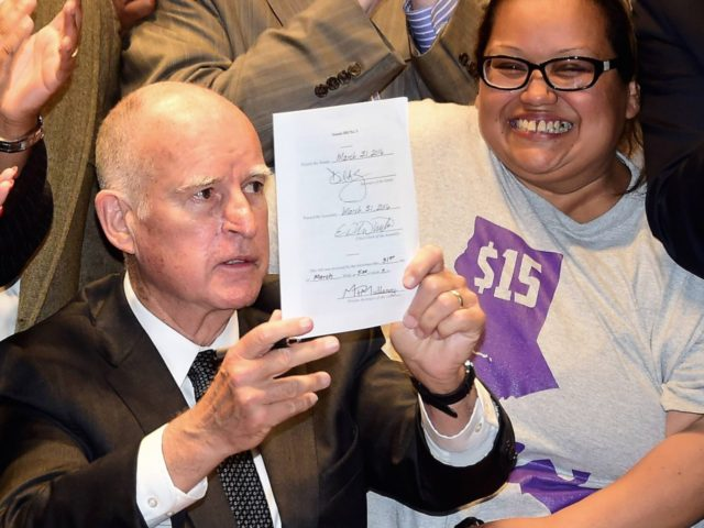 Jerry Brown minimum wage $15 (Frederic J. Brown / AFP / Getty)