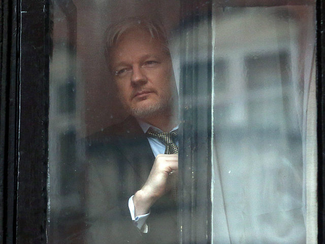 LONDON, ENGLAND - FEBRUARY 05: Wikileaks founder Julian Assange prepares to speak from the balcony of the Ecuadorian embassy where he continues to seek asylum following an extradition request from Sweden in 2012, on February 5, 2016 in London, England. The United Nations Working Group on Arbitrary Detention has insisted that Mr Assange's detention should be brought to an end. (Photo by Carl Court/Getty Images)