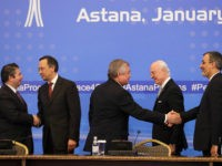 Turkish Foreign Ministry Deputy Undersecretary Sedat Onal, left, and Kazakh Foreign Minister Kairat Abdrakhmanov shake hands, as Russia's special envoy on Syria Alexander Lavrentiev and Iran's Deputy Foreign Minister Hossein Jaber Ansari, right, shake hands and UN Syria envoy Staffan de Mistura stand after the final statement following the talks …