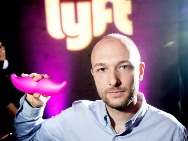 "FILE - In this Monday, Jan. 26, 2015, file photo, Logan Green, co-founder and chief executive officer of Lyft, displays his company's ""glowstache"" during a launch event in San Francisco. On Monday, Jan. 4, 2016, General Motors Co. announced it is investing $500 million in ride-sharing company Lyft Inc. GM …"