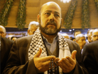 Hamas deputy leader Mousa abu Marzouk reads verses of the Quran for the spirits of Palestinian martyrs during the opening of the National Palestinian Meeting on January 23, 2008 in Damascus, Syria. Oposition Palestinian factions gathered with representatives of Hizbullah and Iran, in a summit aiming to reform the Palestinian Liberation Organization (PLO). (Photo by Salah Malkawi/Getty Images)