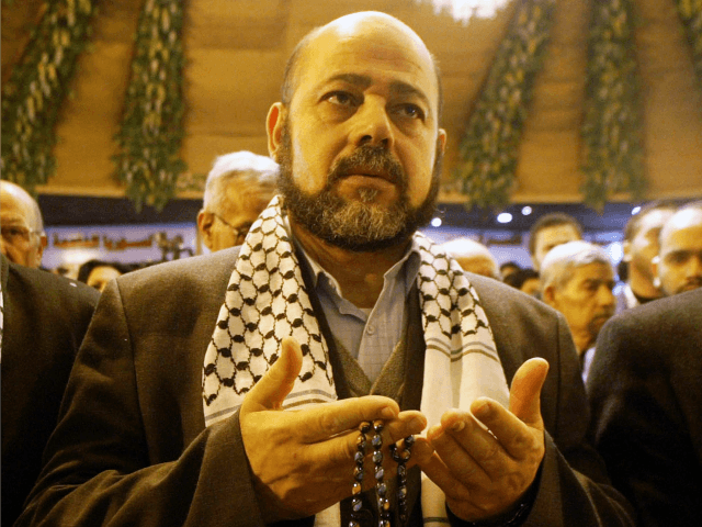 Hamas deputy leader Mousa abu Marzouk reads verses of the Quran for the spirits of Palestinian martyrs during the opening of the National Palestinian Meeting on January 23, 2008 in Damascus, Syria. Oposition Palestinian factions gathered with representatives of Hizbullah and Iran, in a summit aiming to reform the Palestinian …