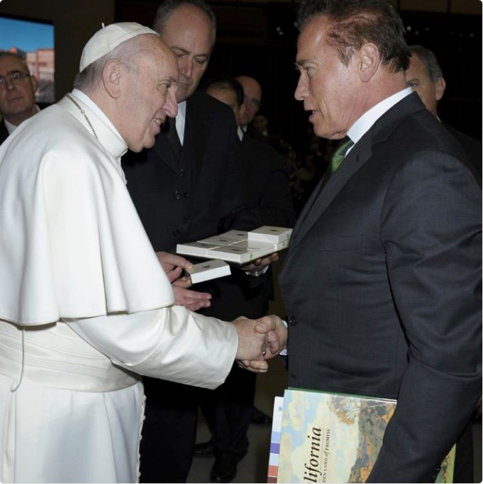 Arnold Schwarzenegger gives Pope Francis a book on California.