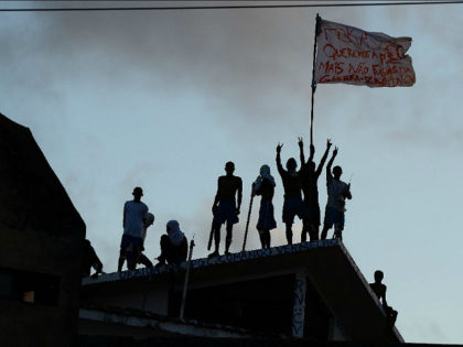 Prisioners atop the roof of the compound celebrate the transfer of their leaders after a negotiation with the police at the Alcacuz Penitentiary, near Natal, Rio Grande do Norte, on January 16, 2017. Authorities thought inmates at the Alcacuz jail near the northeastern city of Natal were under control following …