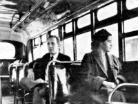 This an undated photo shows Rosa Parks riding on the Montgomery Area Transit System bus. Parks refused to give up her seat on a Montgomery bus on Dec. 1, 1955, and ignited the boycott that led to a federal court ruling against segregation in public transportation. In 1955, Montgomery's racially …