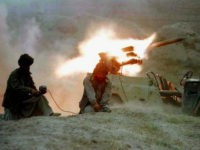 Taliban fighters fire a jeep-mounted BM-12 rocket towards a village north of Kabul, October 11, 1996. REUTERS/File