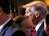 Trump Leaves a Meeting Reuters