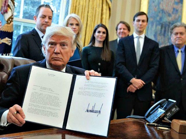 Trump Signs Exec Acts Evan VucciAP
