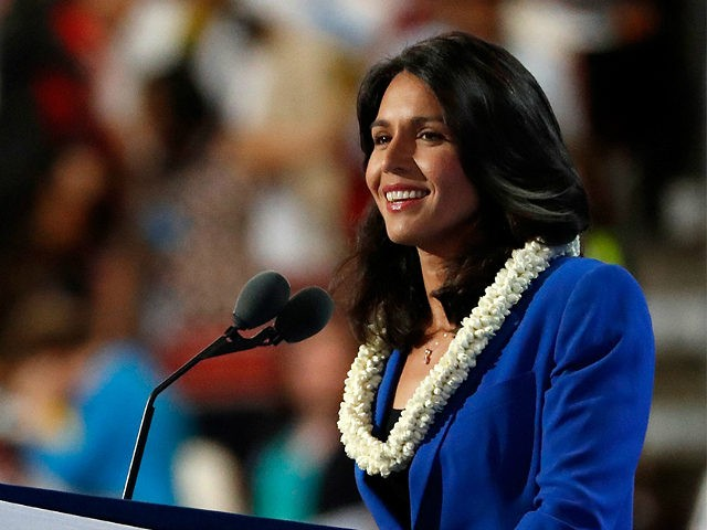 PHILADELPHIA, PA - JULY 26: US representative Tulsi Gabbard (D-HI) delivers remarks on the second day of the Democratic National Convention at the Wells Fargo Center, July 26, 2016 in Philadelphia, Pennsylvania. An estimated 50,000 people are expected in Philadelphia, including hundreds of protesters and members of the media. The …