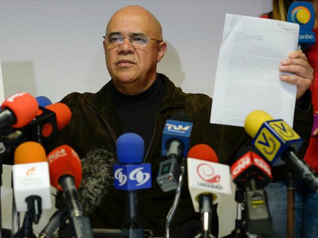 The secretary general of the Venezuelan opposition Democratic Unity Roundtable (MUD), Jesus Torrealba, show a letter from the Vatican's Secretary of State, Italian cardinal Pietro Parolin, during a press conference in Caracas on December 26, 2016. Venezuela's opposition said on December 24 it would not resume stalled talks with the …