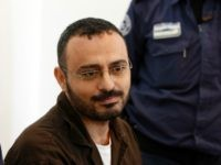 Palestinian Waheed Borsh, a UN Development Programme employee in Gaza who is accused of aiding the Islamist movement Hamas, looks on during his indictment at a district court in the southern Israeli city of Beersheva on August 28, 2016. / AFP / AHMAD GHARABLI (Photo credit should read AHMAD GHARABLI/AFP/Getty …