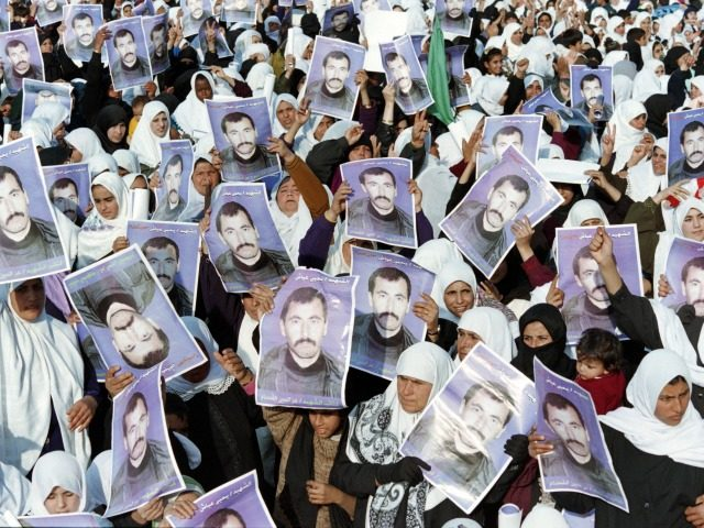 Followers of Palestinian Islamic movement Hamas hold pictures of Yahya Ayash during a rally in Gaza City on January 12, 1996 to commemorate the killing of Yahia Ayash who was the alleged mastermind of suicide bomb attacks against Israel. Hamas militant Yehiya Ayash, nicknamed 'the engineer', was killed on January …