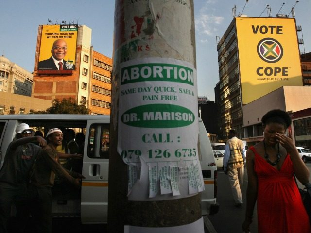 Large campaign posters for ANC President Jacob Zuma (L), and the new opposition Congress of the People party (R) cover the sides of buildings April 18, 2009 in downtown Johannesburg, South Africa. The Christian right has been pressuring political parties to restrict abortion rights in South Africa, which are among …