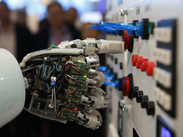 The hand of humanoid robot AILA (artificial intelligence lightweight android) operates a switchboard during a demonstration by the German research centre for artificial intelligence at the CeBit computer fair in Hanover March, 5, 2013. REUTERS/Fabrizio Bensch/Files
