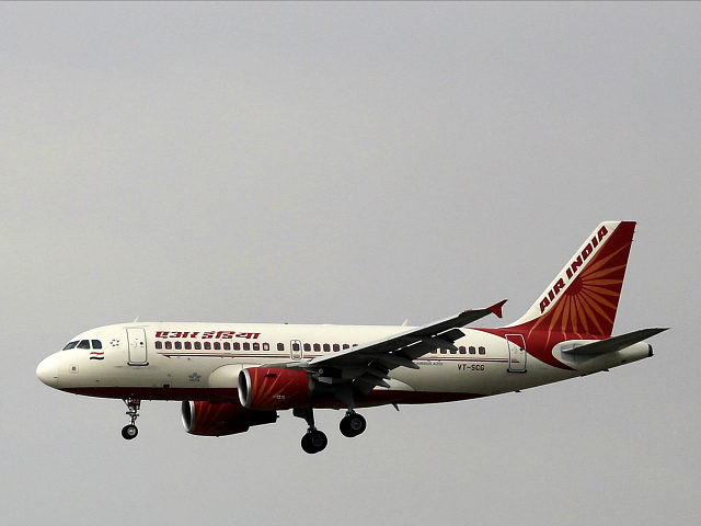 FILE - In this April 16, 2015 file photo, an Airbus A319 of Air India prepares to land at the Indira Gandhi International airport in New Delhi, India. Airport and airline authorities in India on Thursday, Dec. 17, 2015 began investigating the death of a technician who was sucked into an aircraft engine at an airport in Mumbai. (AP Photo/Altaf Qadri, File)