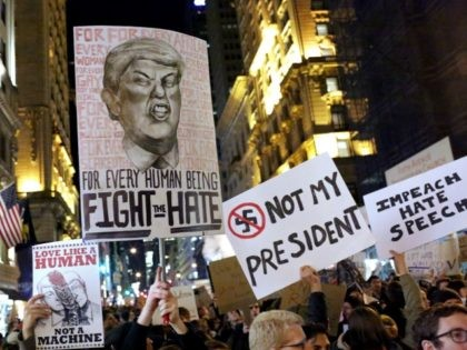 NEW YORK, NY - NOVEMBER 12: A crowd marches from Union Square to Trump Tower in protest of new Republican president-elect Donald Trump on November 12, 2016 in New York, United States. (Photo by Yana Paskova/Getty Images)