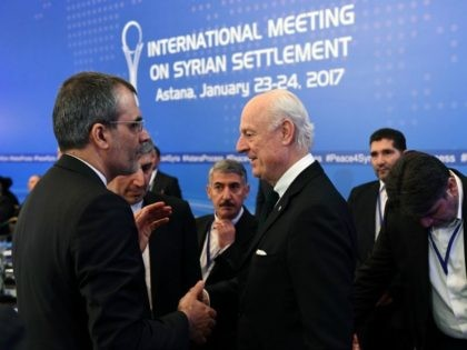 UN envoy for Syria Staffan de Mistura (C) meets with an Iranian delegation prior to the first session of Syria peace talks at Astana's Rixos President Hotel on January 23, 2017. / AFP / Kirill KUDRYAVTSEV (Photo credit should read KIRILL KUDRYAVTSEV/AFP/Getty Images)