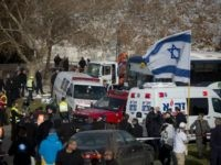 JERUSALEM, ISRAEL - JANUARY 08: (ISRAEL OUT) Israeli security forces and emergency personnel gather at the site of a vehicle-ramming attack on January 8, 2017 in Jerusalem, Israel. Four israeli soldiers were killed and 13 wounded after an industrial truck driven by a Palestinian man, rammed into a group of …