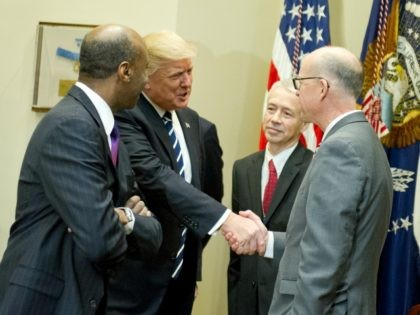 "United States President Donald Trump greets representatives from PhRMA, the Pharmaceutical Research and Manufacturers of America in the in the Roosevelt Room of the White House in Washington, DC on Tuesday, January 31, 2017. According to its website PhRMA ""represents the country's leading biopharmaceutical researchers and biotechnology companies."" Credit: Ron …"