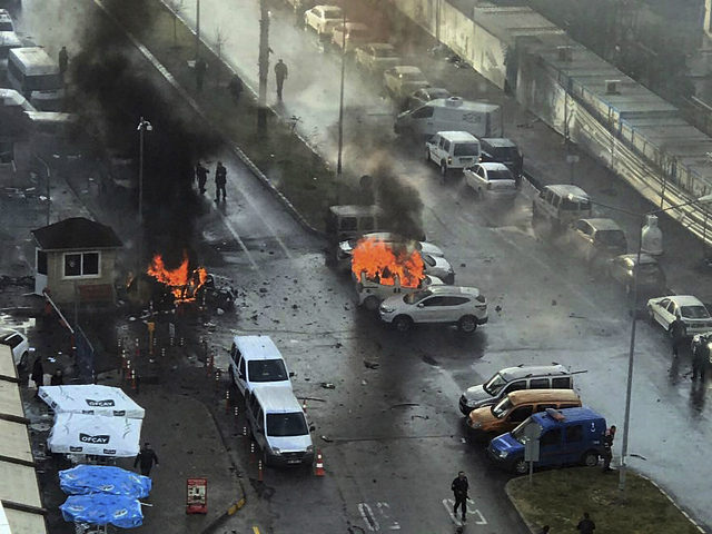 Cars burn after a car bomb explosion in Izmir, Turkey, Thursday, Jan. 5, 2017. An explosion believed to have been caused by a car bomb in front of a courthouse in the western Turkish city of Izmir on Thursday wounded several people, a local official said. Two of the suspected …