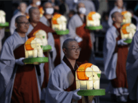 Buddhist monk carry colorful lanterns as they celebrate the forthcoming birthday of Buddha at Jogye temple on May 7, 2016 in Seoul, South Korea. Buddha was born approximately 2,560 years ago, and although the exact date is unknown, Buddha's official birthday is celebrated on the full moon in May in South Korea, which is on May 14 this year. (Photo by Chung Sung-Jun/Getty Images)