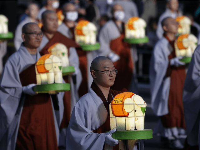 Buddhist monk carry colorful lanterns as they celebrate the forthcoming birthday of Buddha at Jogye temple on May 7, 2016 in Seoul, South Korea. Buddha was born approximately 2,560 years ago, and although the exact date is unknown, Buddha's official birthday is celebrated on the full moon in May in …