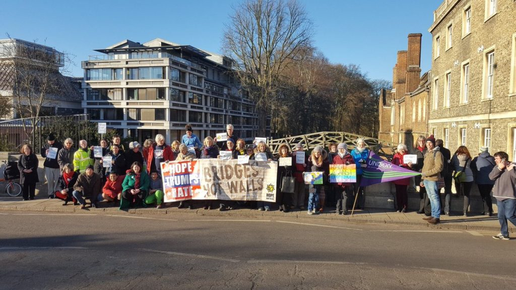 Cambridge Protesters, with the Mathematical Bridge behind