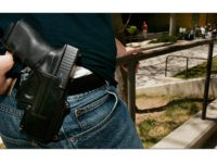 Brent Tenney displays his Glock 9mm semi-automatic handgun on the University of Utah campus where he is a student Wednesday, April 25, 2007, in Salt Lake City. Tenney says he feels relatively safe when he goes to class at the university, but the 24-year-old business major doesn't want to take …