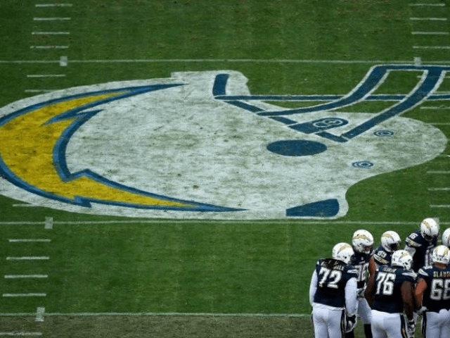 The offense of the San Diego Chargers, seen in huddle during a NFL game at Qualcomm Stadium in San Diego, California, on January 1, 2017