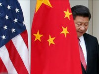 Chinese President Xi Jinping steps out from behind China's flag as he takes his position for his joint news conference with President Barack Obama, Friday, Sept. 25, 2015, in the Rose Garden of the White House in Washington. (AP Photo/Evan Vucci)